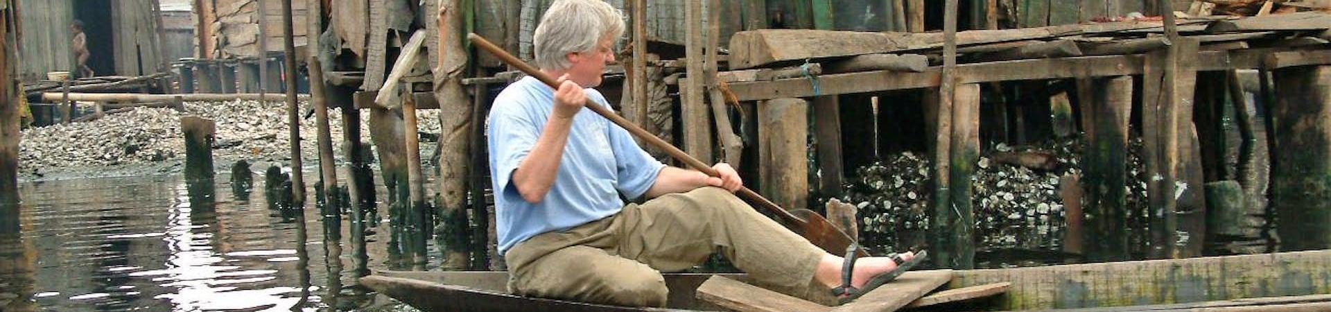 Lars Soeftestad, paddling boat in Nigeria